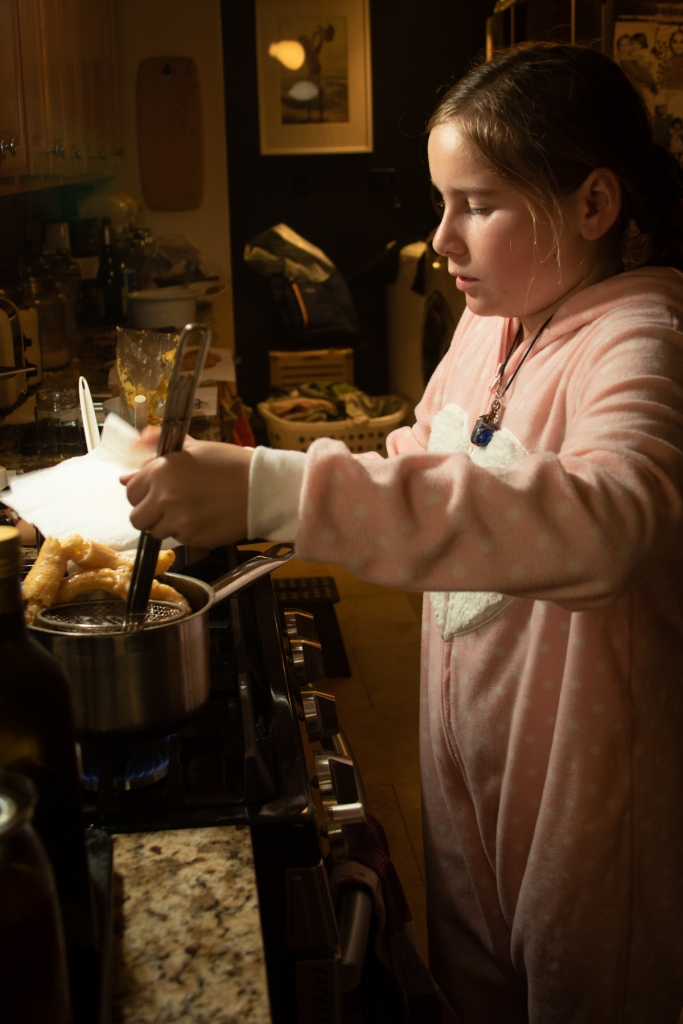 child cooking churros